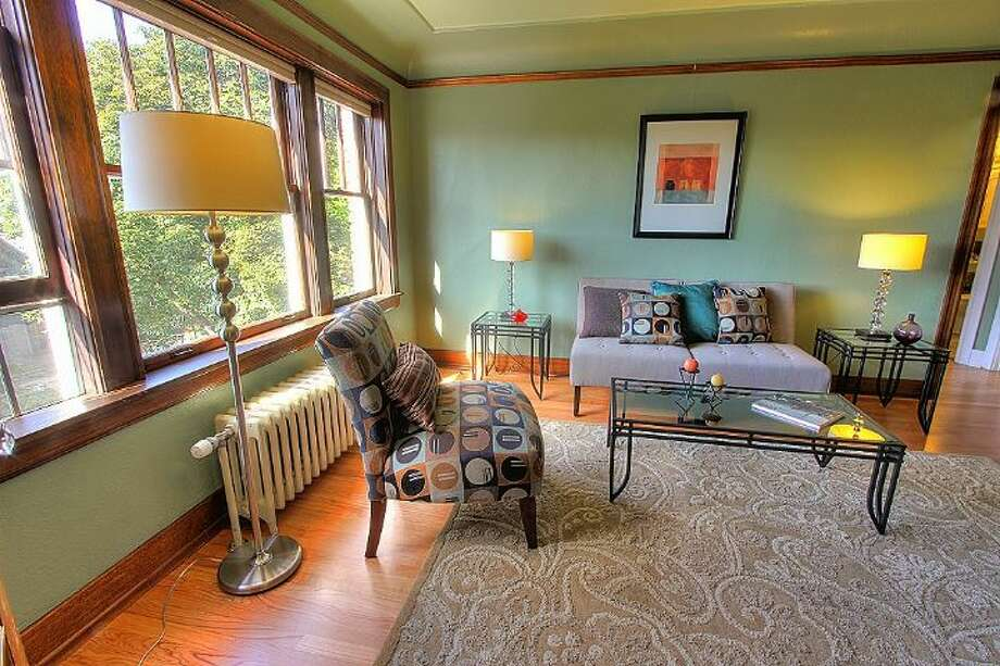 We'll end with the priciest home on our tour, 1631 16th Ave., No. 309. The 644-square-foot condo has one bedroom, one bathroom, coved ceilings, exposed woodwork, picture rail, leaded glass, radiators, and wood and tile floors in a 1929 building with a courtyard and fountain. It's listed for $279,950. Photo: Courtesy Georgia Selfridge,  Windermere Real Estate