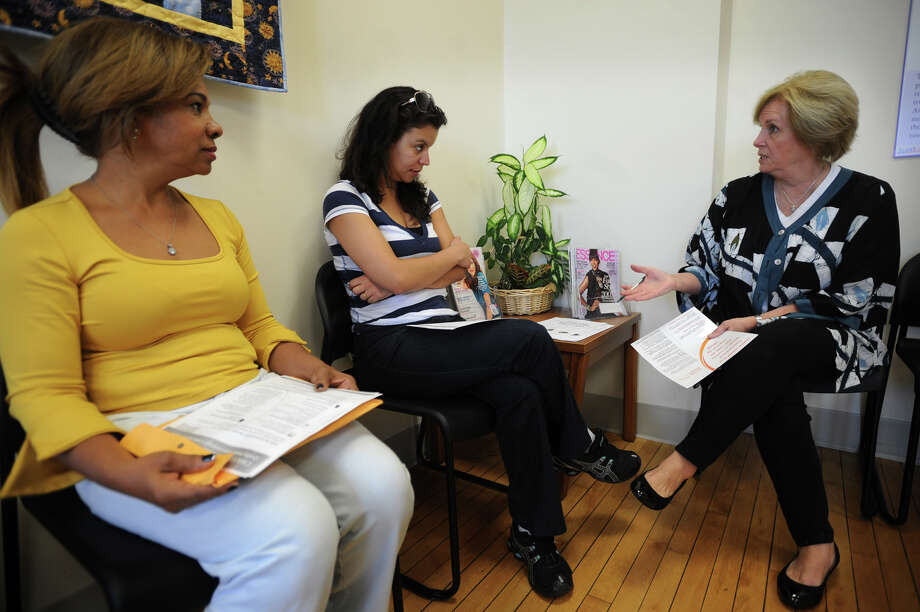 From left; Joselita de Souza, of Fairfield, and Patricia Santana, of Shelton, meet with Executive Director Karen Gottlieb to discuss their options for obtaining health insurance on the opening day of enrollment of the Affordable Care Act at the Weisman AmeriCares Free Clinic at 115 Highland Avenue in Bridgeport, Conn. on Tuesday, October 1, 2013. Photo: Brian A. Pounds / Connecticut Post