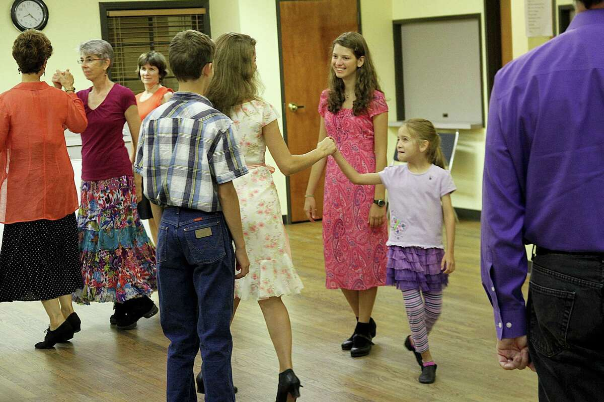 The English country dancing gatherings at St. Andrews Episcopal Church in the Heights draw participants of all ages.