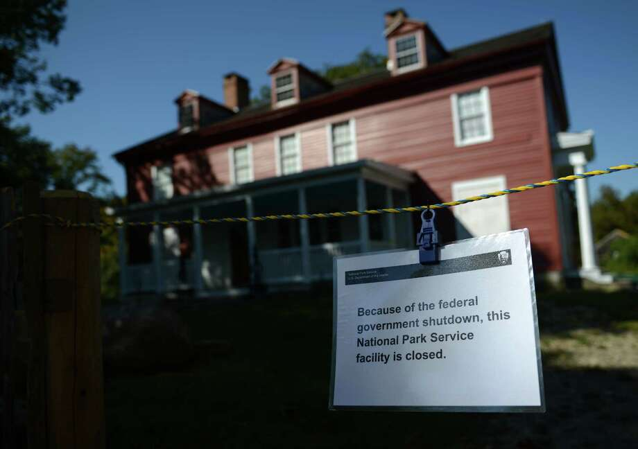 A sign outside of Weir Farm National Historic Site in Wilton, Conn., explains why the park is closed. Photo: Tyler Sizemore / The News-Times