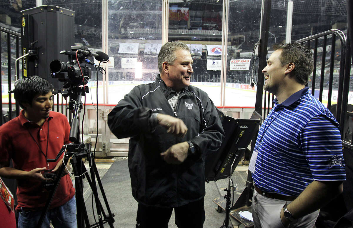 Coach Peter Horachek jokes with reporters as the Rampage hockey team conducts media day at the AT&T Center on October 1, 2013