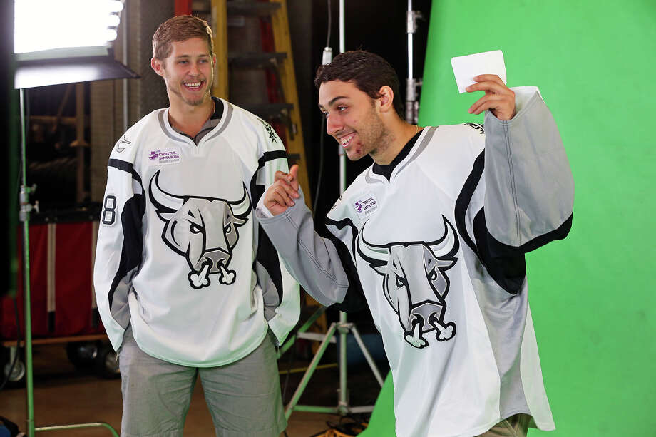Vincent Trocheck (right) tries to give clues to John Lee in a game of charades on camera as the Rampage hockey team conducts media day at the AT&T Center  on October 1, 2013 Photo: TOM REEL
