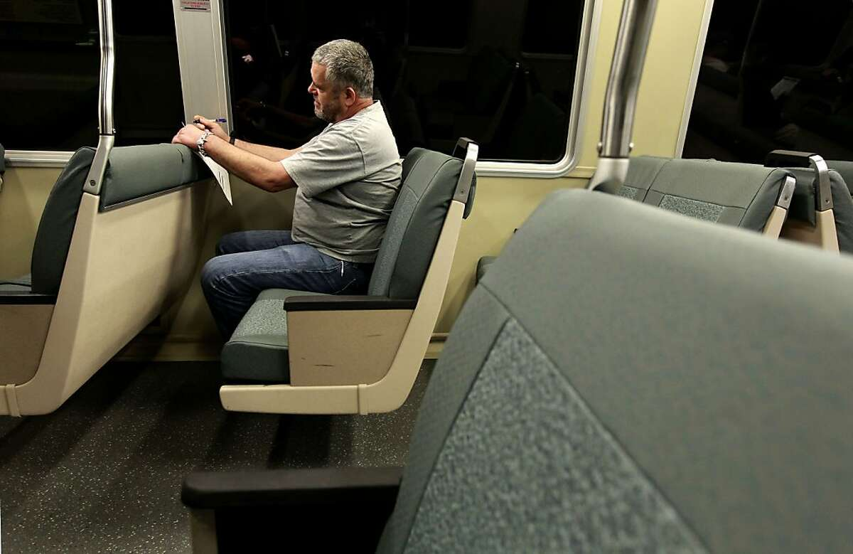 Jim Kyser, of Alameda, fills out a survey form about new BART seats, on Tuesday April 3, 2012 in Oakland, Calif.
