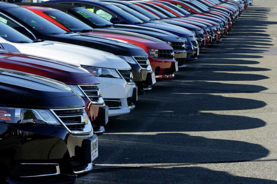 In this Wednesday, Sept. 18, 2013 photo Chevrolet passenger cars form a row on a dealer's lot in Needham, Mass. U.S. auto sales for September are released on Tuesday, Oct. 1, 2013. (AP Photo/Steven Senne_ ORG XMIT: NYBZ110 Photo: Steven Senne / AP