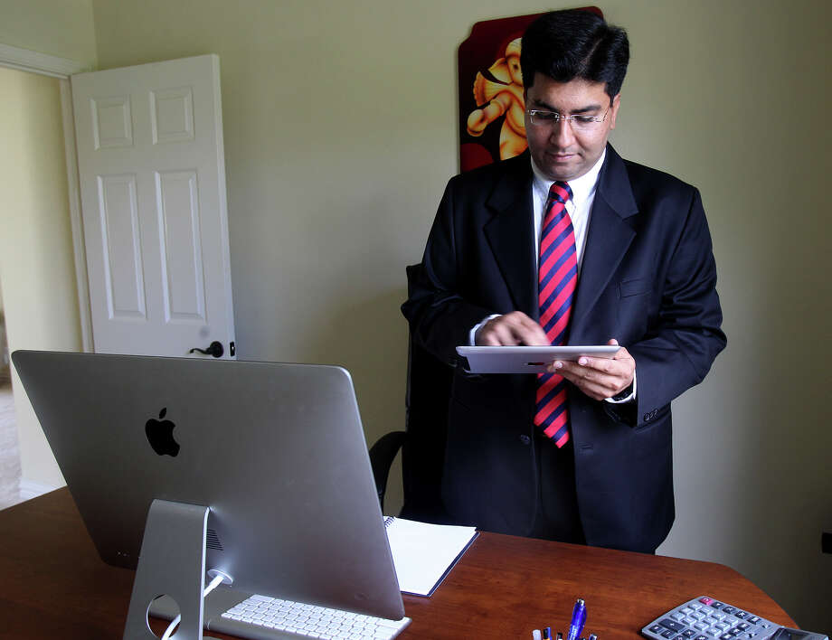 Nitin Sharma is the CEO and founder of Gold Research, which works with clients that include restaurant chains and retail outlets to help them understand their customers better. Sharma uses ipads and Samsung tablets to get opinions from diners and shoppers. Sharma works out of his home. Photo: JOHN DAVENPORT, SAN ANTONIO EXPRESS-NEWS / ©San Antonio Express-News/Photo may be sold to the public
