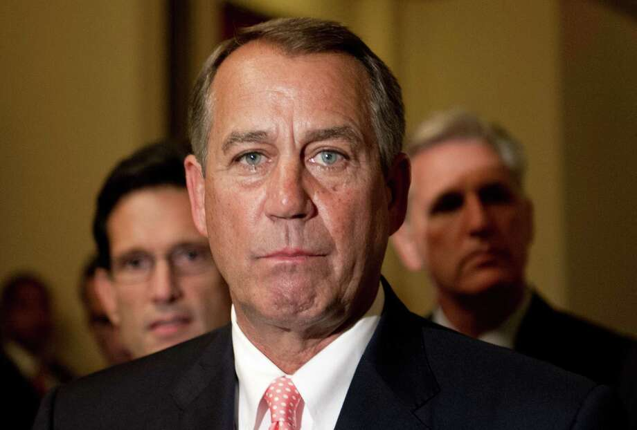 Now that House Speaker John Boehner has caught the car, he should let it go as soon as possible. Photo: NICHOLAS KAMM, AFP/Getty Images / AFP