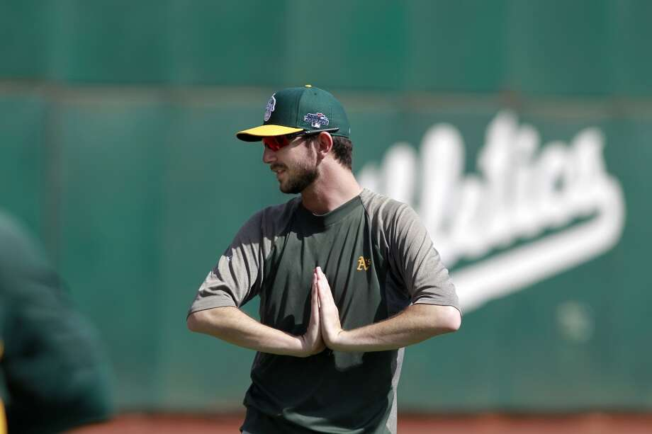 A's pitcher Jerry Blevins , stretches during workouts, on Tuesday Oct. 1, 2013, in Oakland, Calif. at O.co Coliseum as the Oakland Athletics get ready for their divisional series against the Detroit Tigers. Photo: The Chronicle