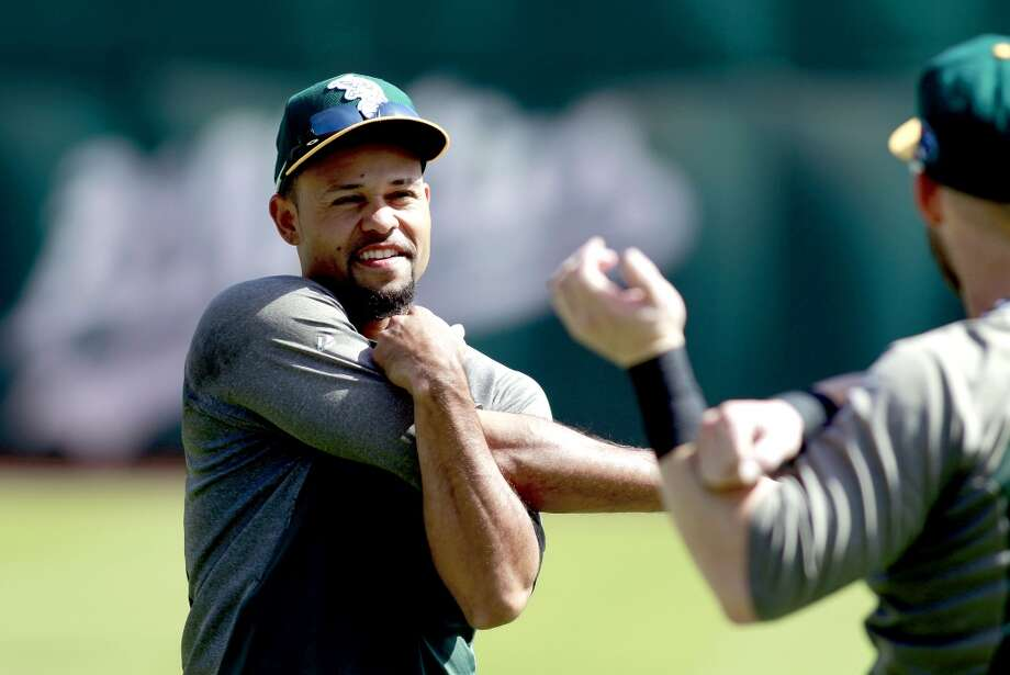A's Coco Crisp, stretches during workouts, on Tuesday Oct. 1, 2013, in Oakland, Calif. at O.co Coliseum as the Oakland Athletics get ready for their divisional series against the Detroit Tigers. Photo: The Chronicle