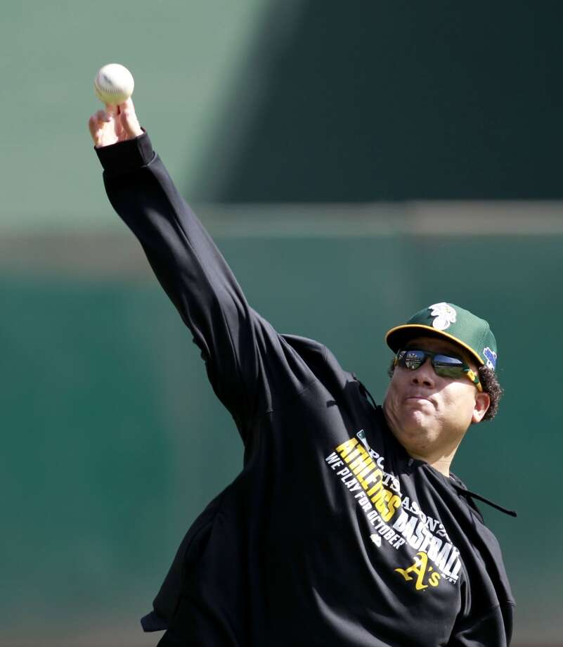 A's pitcher Bartolo Colon, warms up during workouts, on Tuesday Oct. 1, 2013, in Oakland, Calif. at O.co Coliseum as the Oakland Athletics get ready for their divisional series against the Detroit Tigers. Photo: The Chronicle