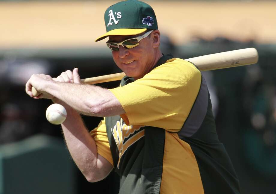 A's manager Bob Melvin hits grounders during infield practice on Tuesday Oct. 1, 2013, in Oakland, Calif. at O.co Coliseum as the Oakland Athletics get ready for their divisional series against the Detroit Tigers. Photo: The Chronicle