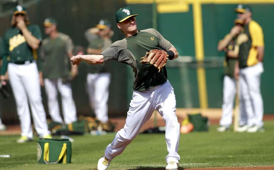 A's Josh Donaldson takes infield practice during workouts, on Tuesday Oct. 1, 2013, in Oakland, Calif. at O.co Coliseum as the Oakland Athletics get ready for their divisional series against the Detroit Tigers. Photo: The Chronicle