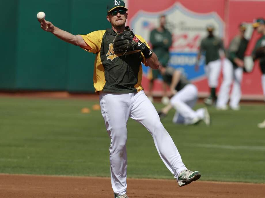 A's Jed Lowrie takes infield practice on Tuesday Oct. 1, 2013, in Oakland, Calif. at O.co Coliseum as the Oakland Athletics get ready for their divisional series against the Detroit Tigers. Photo: The Chronicle