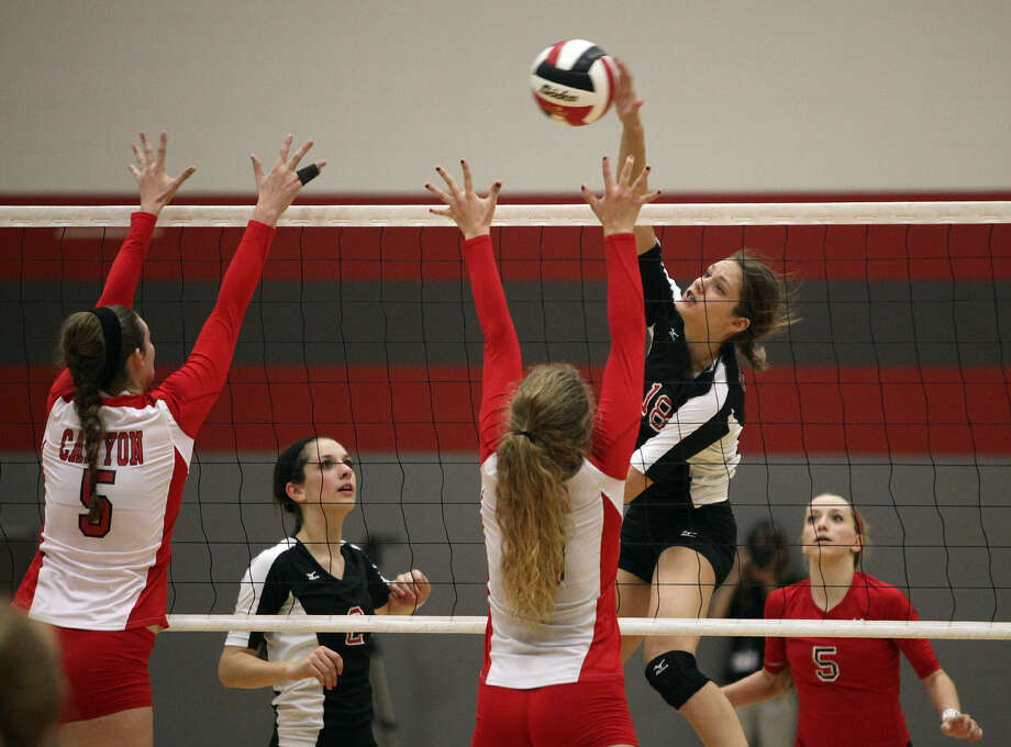 Churchill's Taylor Martinez (18), right, goes up against New Braunfels Canyon in a Class 5A playoff match last year at Judson High School.