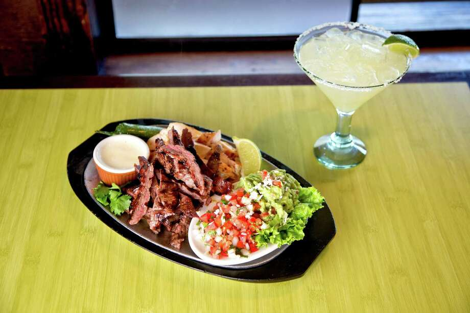 Through Oct. 30, all Pappasito's will participate in weekly specials, namely beef and chicken fajitas. The chain also is rolling out an anniversary drink, Pappasito's Reserva Margarita, in a commemorative glass. Photo: Thomas B. Shea / © 2013 Thomas B. Shea