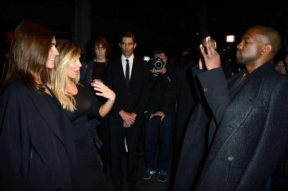 Catherine Roitfeld and Kim Kardashian pose for Kanye West as they attend the Givenchy show as part of the Paris Fashion Week Womenswear  Spring/Summer 2014 on September 29, 2013 in Paris, France.  (Photo by Pascal Le Segretain/Getty Images) Photo: Pascal Le Segretain, Getty Images