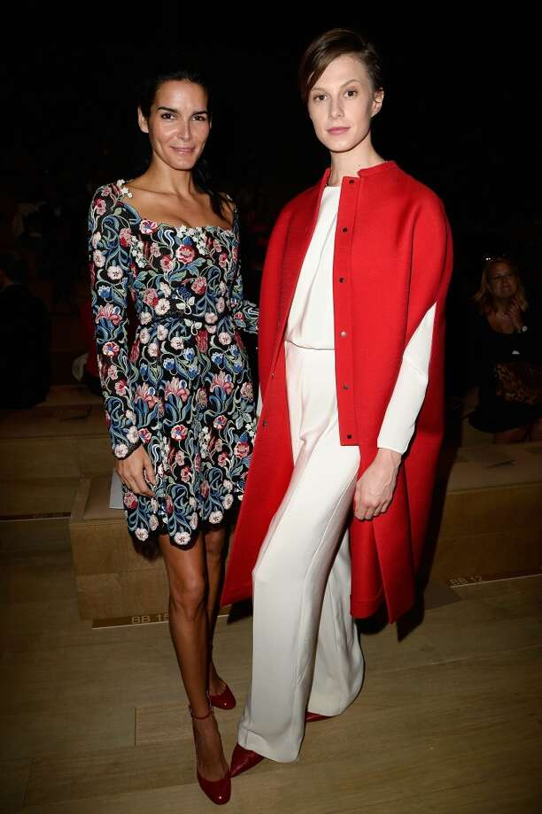 Angie Harmon and Elettra Rossellini Wiedemann attend the Valentino show as part of the Paris Fashion Week Womenswear  Spring/Summer 2014 at Espace Ephemere Tuileries on October 1, 2013 in Paris, France.  (Photo by Pascal Le Segretain/Getty Images) Photo: Pascal Le Segretain, Getty Images