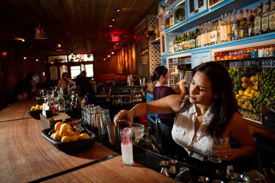 Alba Huerta makes a drink at The Pastry War, a new tequila bar downtown which serves agave-based spirits: tequila, mezcal and sotol. ( Michael Paulsen / Houston Chronicle ) Photo: Michael Paulsen, Houston Chronicle