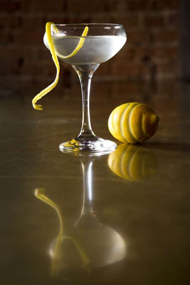 The Gatsby Martini is shown at Goro & Gun.  The Gatsby is made with two ounces of Hendrick's gin, one ounce of Dolin blanc vermouth, orange bitters and a lemon zest. ( Brett Coomer / Houston Chronicle ) Photo: Brett Coomer, Houston Chronicle
