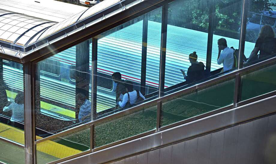 Travelers board a New York City bound Amtrak train Tuesday Oct. 1, 2013, at the Albany-Rensselaer Train Station in Rensselaer, N.Y.  (John Carl D'Annibale / Times Union) Photo: John Carl D'Annibale / 00024069A