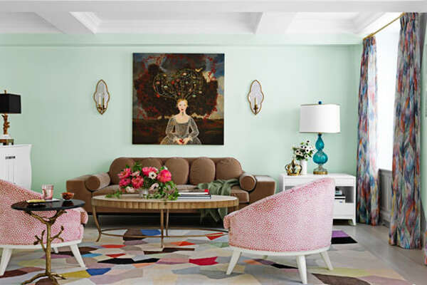 """Mint Green To bring a feeling of nature into a New York living room, designer Fawn Galli used a custom minty green. """"Green is my favorite color because it's of the earth, the trees, the grass,"""" she says. Pal+Smith chairs, Paley sofa from Profiles, and Fiona Curran Palette carpet for The Rug Company. Painting by Anne Siems. 20 Decorating Secrets No One Ever Told You 90+ Amazing Designer Bedrooms 7 Biggest Decorating Mistakes 10 Surprising Ways to Add Color to Your Home 54 Designer Living Room Decorating Ideas"""