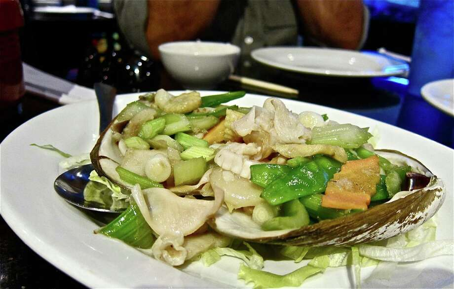 Sauteed live surf clam with vegetables at Hai Cang seafood restaurant. Photo: Alison Cook