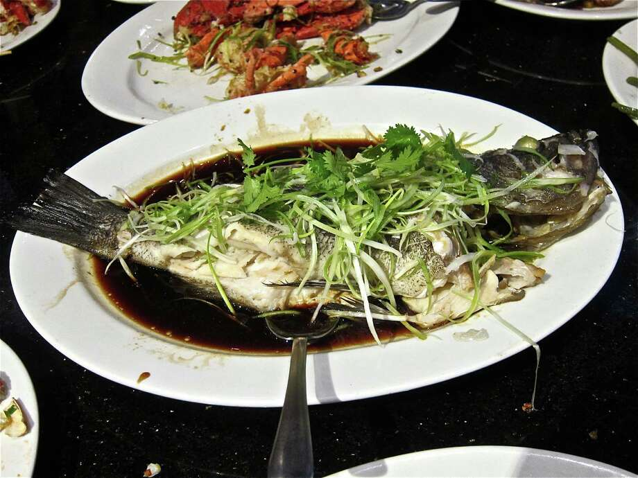 Whole live black sea bass steamed with ginger and scallion at Hai Cang seafood restaurant. Photo: Alison Cook