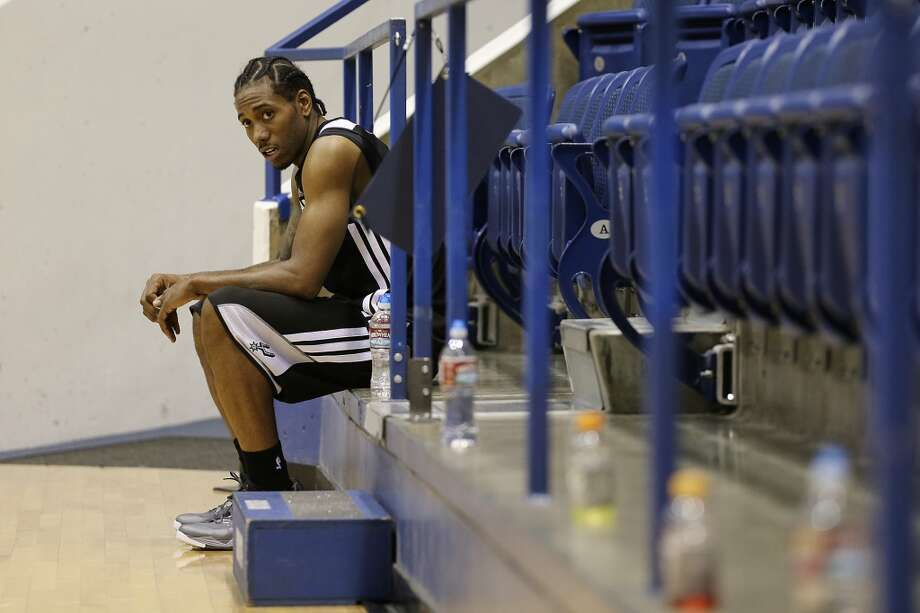 San Antonio Spurs Kawhi Leonard takes a breather after morning team practice at the Clune Arena of the United State Air Force Academy in Colorado Springs, Colorado, Tuesday, Oct. 1, 2013. Photo: Jerry Lara/San Antonio Express-News