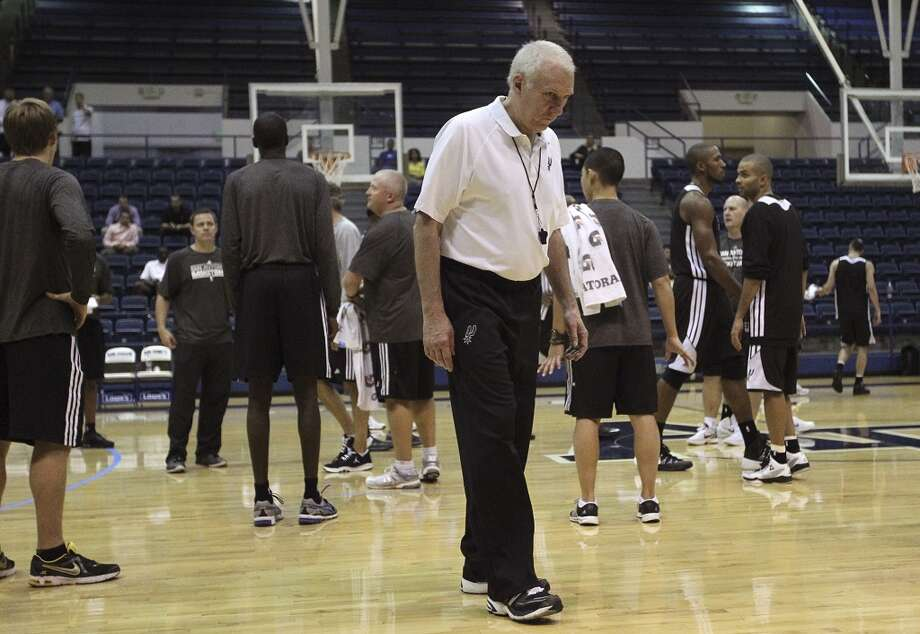 San Antonio Spurs head coach Gregg Popovich head off the court after morning team practice at the Clune Arena if the United State Air Force Academy in Colorado Springs, Colorado, Tuesday, Oct. 1, 2013. Photo: Jerry Lara/San Antonio Express-News