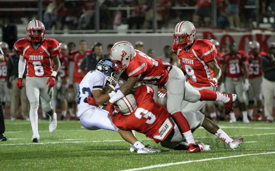 A host of Judson defenders stop a Corpus Christi Carroll ball carrier in his tracks Friday, as the Rockets buried the visiting Tigers, 54-18.