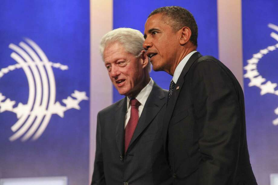 President Barack Obama and former President Bill Clinton last week touted new health care laws. Photo: McClatchy-Tribune Service
