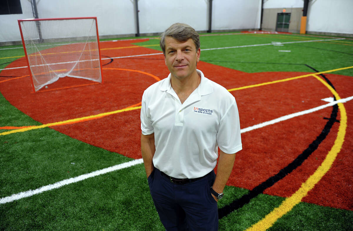 Peter Corbett, co-owner of Insports Centers, poses on one of the many fields at the newly opened facility in Trumbull, Conn. on Tuesday October 1, 2013.
