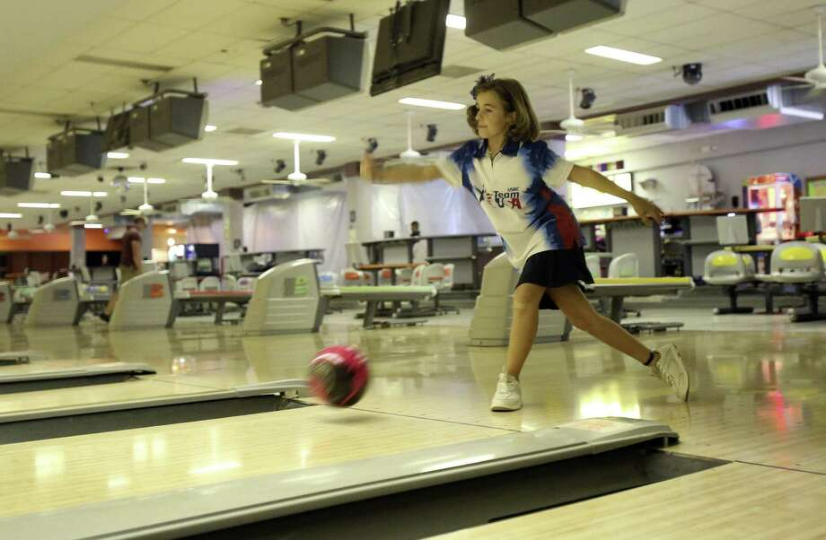 San Antonio junior bowler, Natalie Savant, 9, is bowling her way across 48 states to raise awareness and money for scholarships for junior bowling. Photo: Helen L. Montoya / San Antonio Express-News