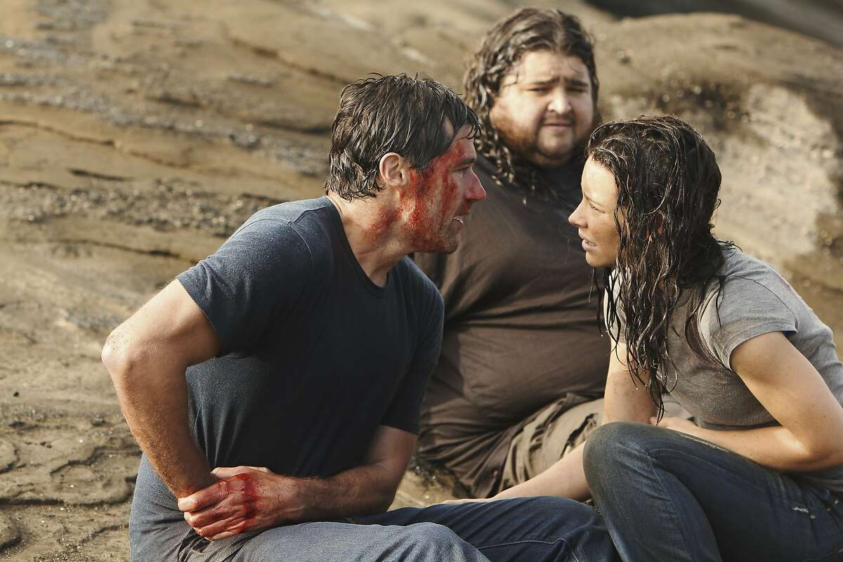 """In this publicity image released by ABC, Matthew Fox, left, Jorge Garcia and Evangeline Lilly, right are shown in a scene from the finale of """"Lost."""""""