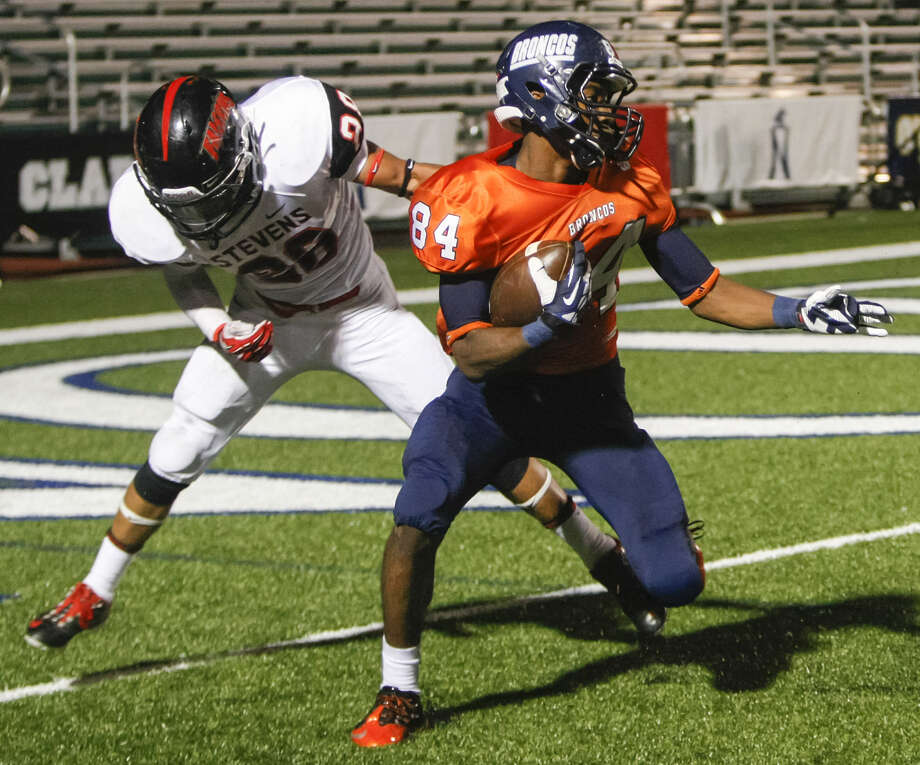 Brandeis wide receiver Larry Stephens (right) spins away from Stevens Romello Garcia at the goal line before scoring a 41-yard touchdown, his second of the night, during the second quarter of their Saturday game. Photo: Marvin Pfeiffer / Northwest Weekly