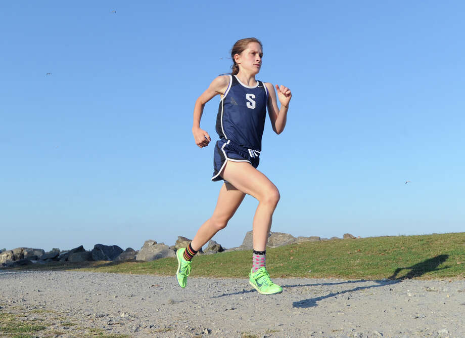 Staples High School runner Hannah DeBalsi during the girls high school cross country race at Greenwich Point, Tuesday afternoon, Oct. 1, 2013. DeBalsi came in first with a Greenwich Point meet record time of 14:55. Photo: Bob Luckey / Greenwich Time