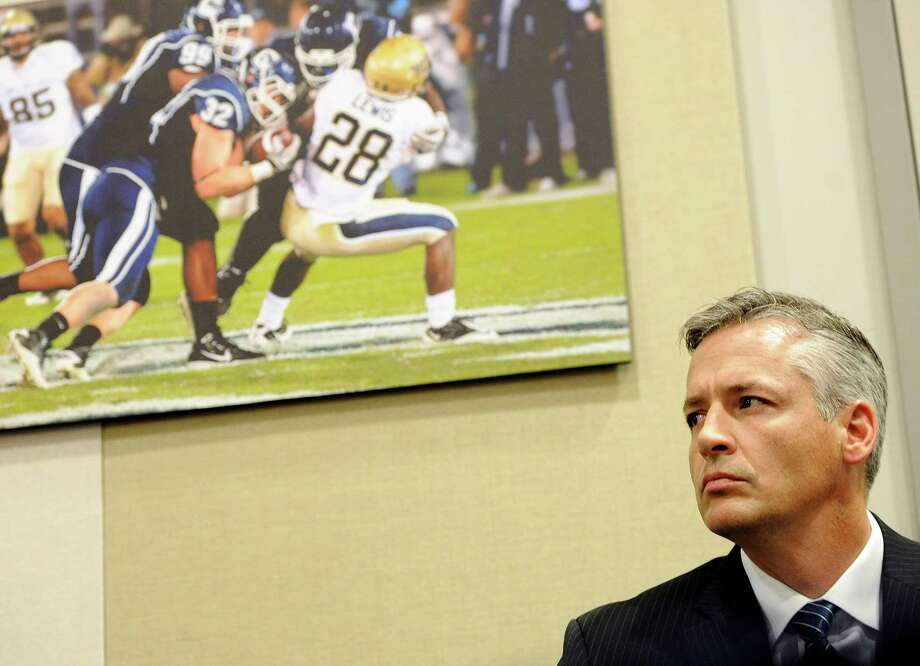 Connecticut interim head coach and former offensive coordinator T.J. Weist listens to a question during an NCAA college football news conference after the dismissal of Connecticut football coach Paul Pasqualoni, Monday, Sept. 30, 2013, in Storrs, Conn. (AP Photo/Jessica Hill) Photo: Jessica Hill, Associated Press / Associated Press