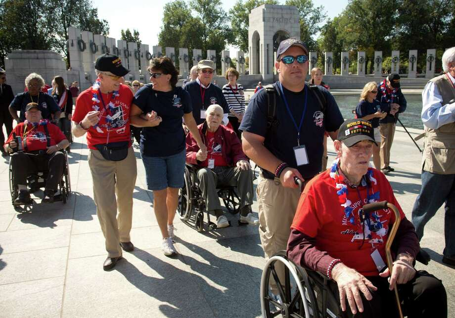 World War II veterans from Mississippi cross barriers to the National World War II Memorial, refusing to comply with signs declaring the facility closed on the first day of a government shutdown in Washington, Oct. 1, 2013. Federal workers across the country braced for an uncertain financial future on Tuesday after Congress gave up hope of passing a budget in the face of Republican attacks on the new health care law. Photo: STEPHEN CROWLEY, NYT / NYTNS