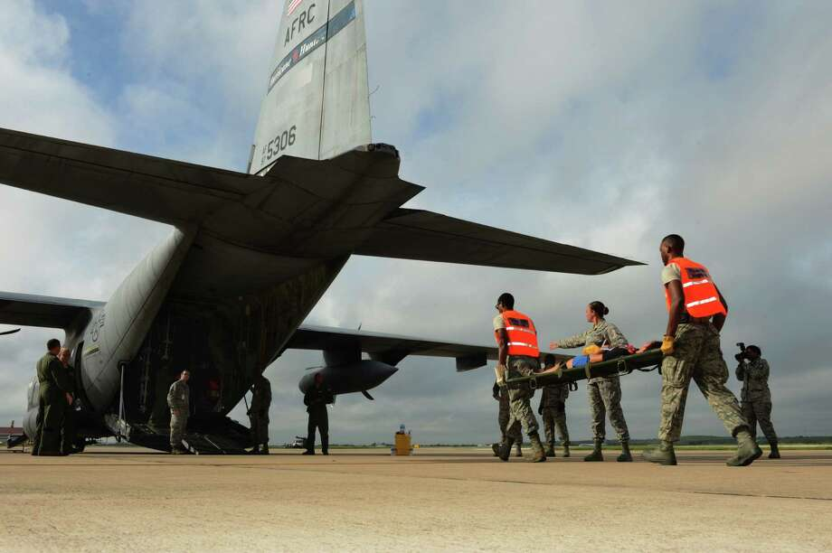 Airmen of the 59th Medical Wing, Joint Base San Antonio-Lackland, carry patients on litters to an aircraft during the San Antonio Mass Casualty Exercise event Sept. 19 at Kelly Field, Port San Antonio. Photo: U.S. Air Force
