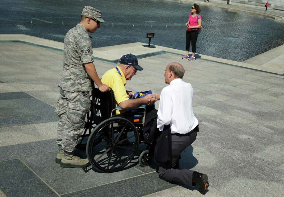 U.S. Rep. Louie Gohmert (R-TX) (R) talks to a military veteran at the World War II Memorial during a government shutdown October 1, 2013 in Washington, DC. The memorial was temporary opened to veteran groups arrived on Honor Flights on a day trip to visit the nation's capital. Photo: Alex Wong, Getty Images / 2013 Getty Images