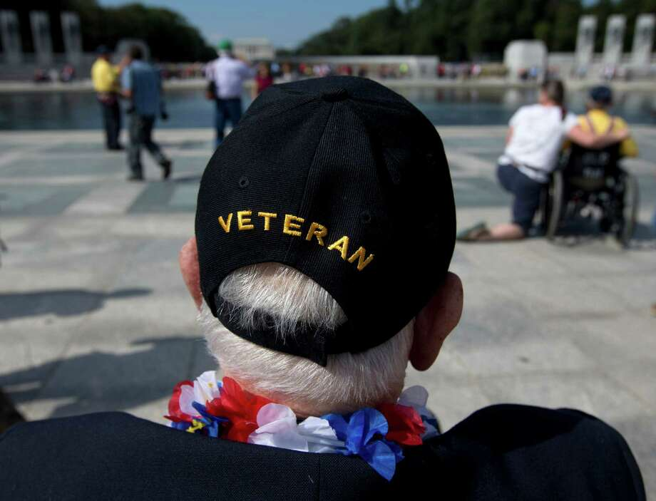 World War II Veteran George Bloss, from Gulfport, Miss., looks out over the National World War II Memorial in Washington, Tuesday, Oct. 1, 2013. Veterans who had traveled from across the country were allowed to visit the National World War II Memorial after it had been officially closed because of the partial government shutdown. After their visit, National World War II Memorial was closed again. Photo: Carolyn Kaster, Associated Press / AP