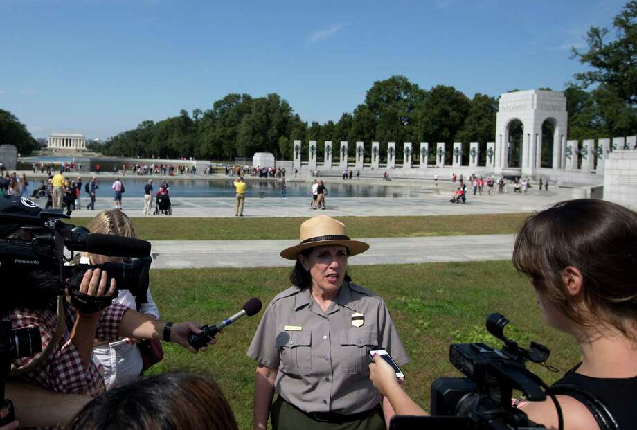 National Park Service spokeswoman Carol Johnson speaks to reporters at the National World War II Memorial in Washington, Tuesday, Oct. 1, 2013. Photo: Carolyn Kaster, Associated Press / AP
