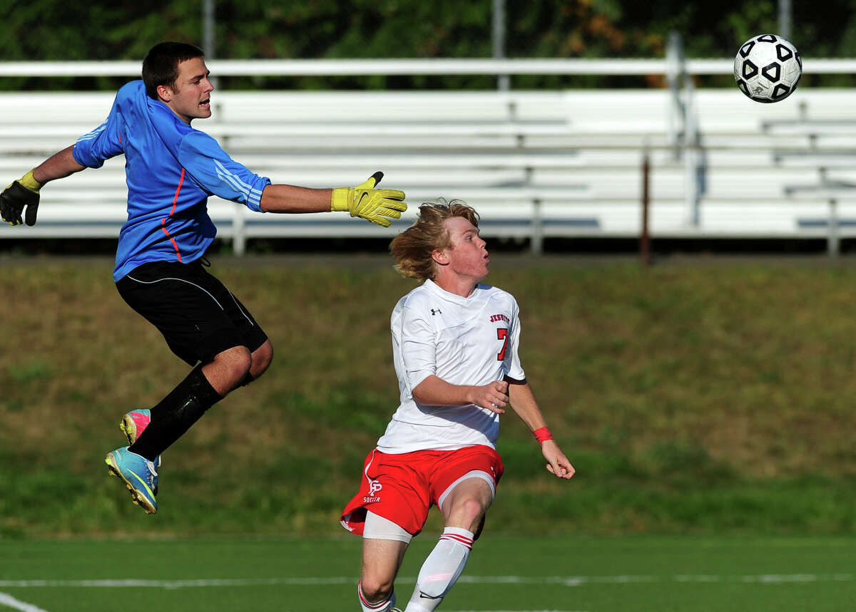 Zavier goalie Dan Miela, left, looks to block a goal attempt by Fairfield Prep's Chris Montani, as the ball comes towards them, during boys high school soccer action in Fairfield, Conn. on Tuesday October 1, 2013.