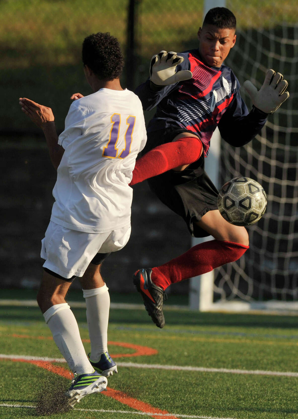 Westhill's Daniel Sasnchez and Central goalie Gustavo Herrera collide during their game at Westhill High School in Stamford, Conn., on Tuesday, Oct. 1, 2013. Westhill beat Central, 2-0.