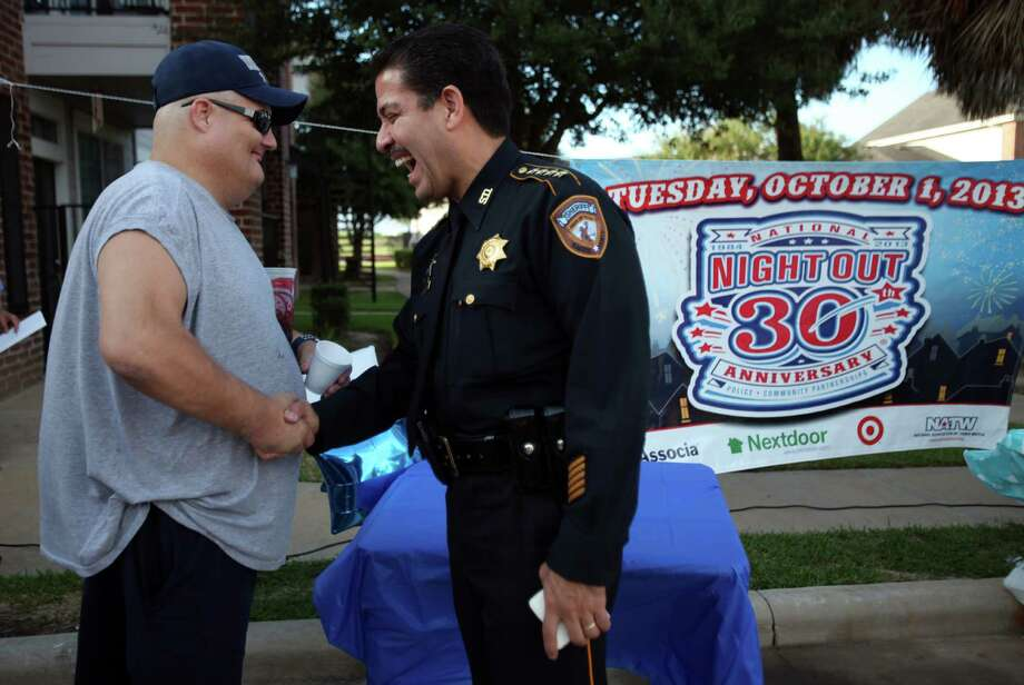 Rusty Goldman meets Harris County Sheriff Adrian Garcia during the National Night Out gathering at the Millstone Apartment Complex on Tuesday, Oct. 1, 2013, in Katy. Photo: Mayra Beltran, Houston Chronicle / © 2013 Houston Chronicle