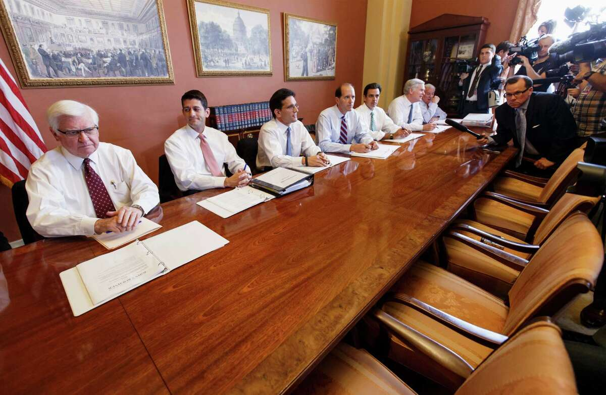 House Majority Leader Eric Cantor of Va., third from left, and fellow with House Republican conferees told reporters that the chairs opposite them were intended for Senate Democrats as part of negotiations on the budget. The Democrats declined the offer, refusing to back down on Obamacare.