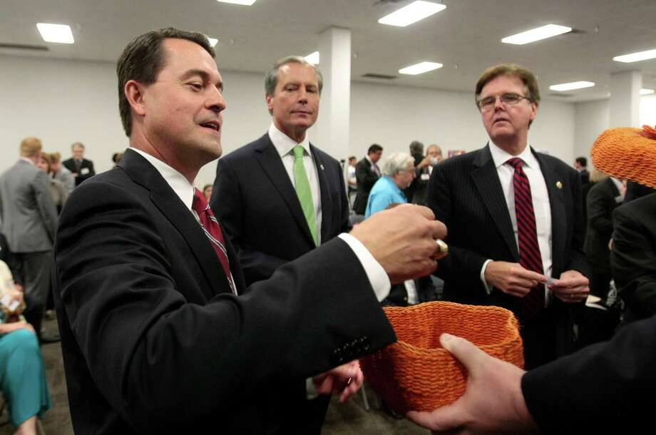 Lieutenant governor candidates — Agriculture Commissioner Todd Staples, left, Lt. Gov. David Dewhurst, and State Sen. Dan Patrick — pull pieces of paper to see who will go first  during their forum at the Sosa Community Center in Houston on Tuesday. Photo: Billy Smith II, Chronicle / © 2013 Houston Chronicle