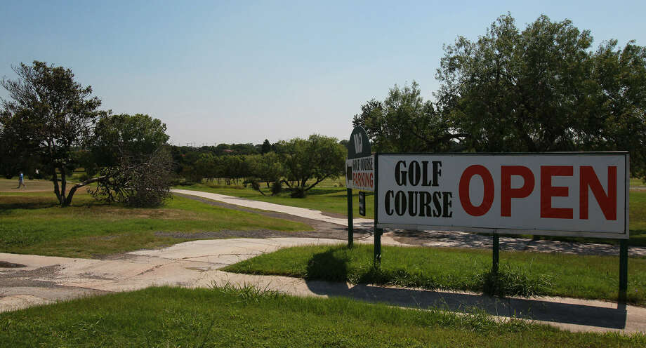 "Though a sign at Woodlake reminds people the course is still open, it might soon shut down while the new owners ""get our hands around it,"" Robert Wehrmeyer, an attorney and spokesman for the buyers, said. Photo: John Davenport / San Antonio Express-News"