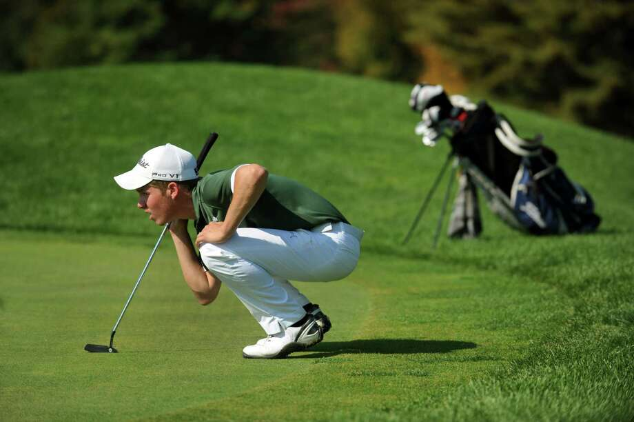Shenendehowa's Kyle Matthews lines up a putt during Section II golf championships on Tuesday, Oct. 1, 2013, at Ballston Spa Country Club in Ballston Spa, N.Y. (Cindy Schultz / Times Union) Photo: Cindy Schultz / 00024043B