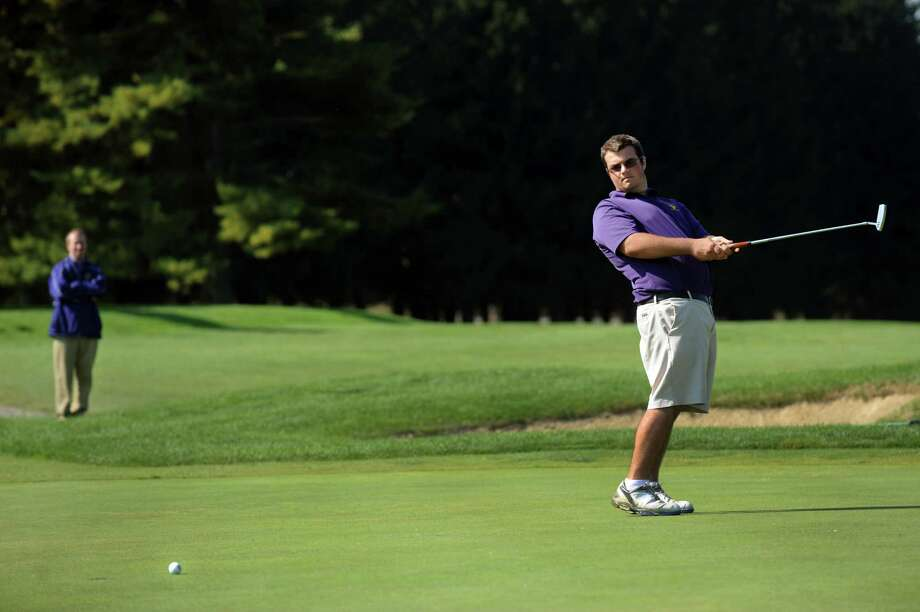 Ballston Spa's Zach Scala, right, uses body English to coax a putt during Section II golf championships on Tuesday, Oct. 1, 2013, at Ballston Spa Country Club in Ballston Spa, N.Y. (Cindy Schultz / Times Union) Photo: Cindy Schultz / 00024043B