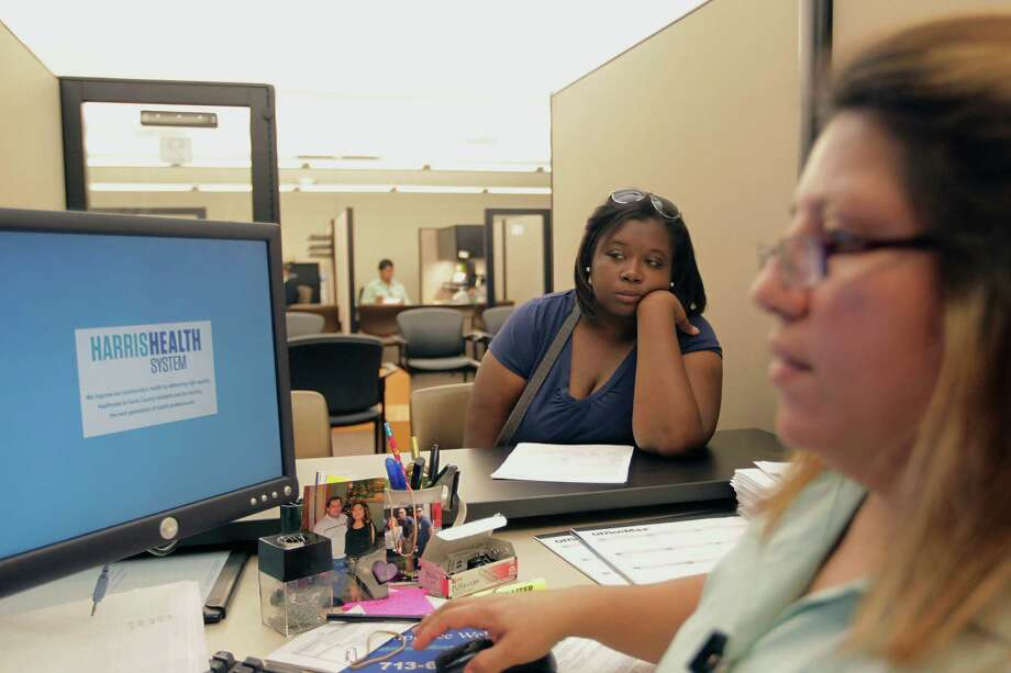 Vanessa Danielle Cotton (left) was helped with insurance enrollment, thanks to the Affordable Care Act, at the Harris Health System eligibility center with ACA Certified Application Counselor Lillian Ardon in 2013, in Houston. Leaders of safety-net providers such as Harris Health were anxious before the Supreme Court ruling. Photo: James Nielsen, Houston Chronicle / © 2013  Houston Chronicle